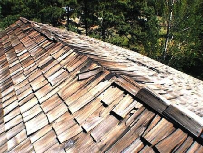 Roof with broken tiles and ridge caps